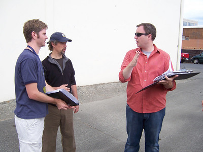 Tim consults with the director of photographer and script supervisor