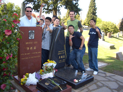 """The next category was """"Death.""""  Eric, Frank, Matt, and Frank found a bunch of new friends to pose with them at Bruce Lee's gravesite."""