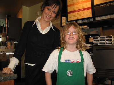 Teams that bring their 12 year old boy with them have the unfair advantage of getting everyone else to play along.  This Starbucks barista was in at least three other teams' photos but this is the only one where she let someone wear her apron.  Well played.