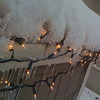 I love the way my Christmas lights have hallowed out the snow and created these great icicles.