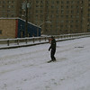 This guy is snowboarding down Denny Way