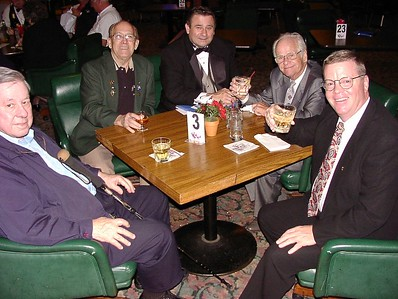 11/26/02 - New initate Tom Sicox is joined by other elks