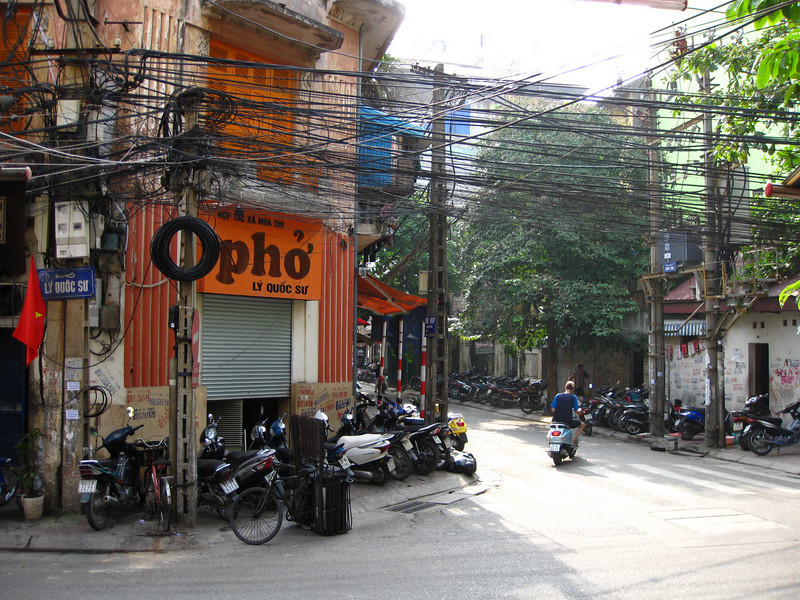 I like this shot. I like the chaos of the power/telephone lines and the rows of motorbikes. Pho is a popular restaurant known for its pho (a vietnamese noodle soup). Unfortunately I took this at a quiet time of the day (midafternoon) when the restaurant wasn't humming.