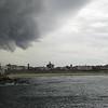 A massive storm front threatens to devour Bondi Beach
