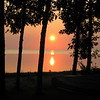 Sunset through the trees at Julie's cabin on Lake Manitoba