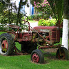 an old Farmall tractor, permanently entrenched in the front garden