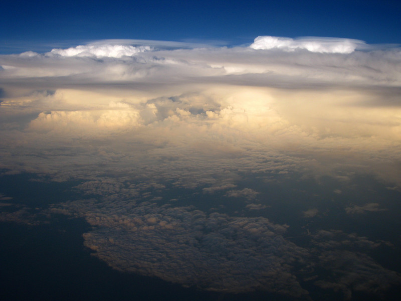 awesome cloud formation as we fly over the transition of ocean to land