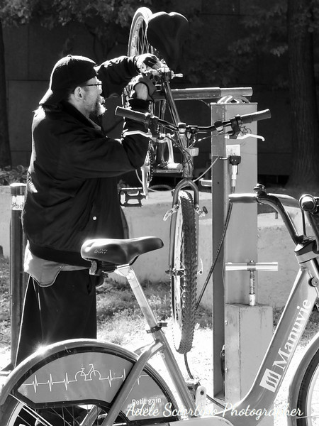 Man Fixing Bike