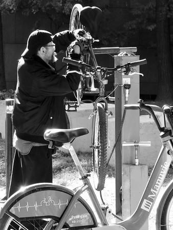 Man Fixing Bike