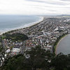 the panorama of Mount Manganui. Omanu Beach stretches into the distance. Port of Tauranga is on the right.