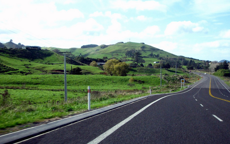 a typical New Zealand landscape. very few roads are 4-lane here, but passing lanes appear fairly often
