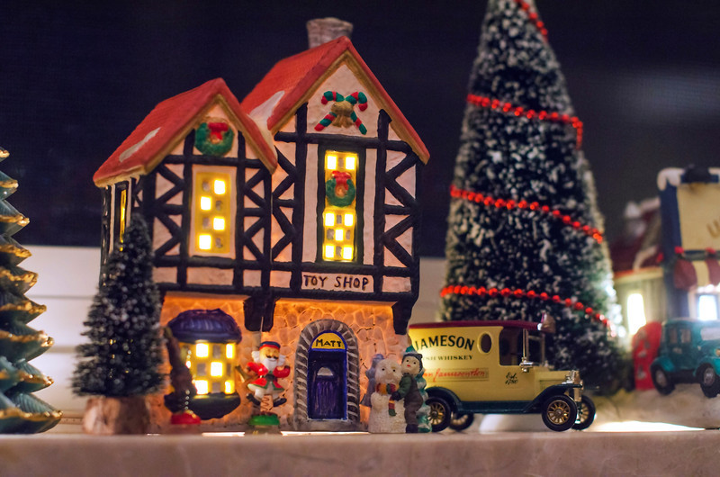 Over the years Mom has hand-painted miniature Christmas Village cottages for each of the family members. This one's mine, and yes, that's a Jameson Whiskey truck parked outside my toy shop.