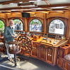 This is Captain Larry Clinton in the pilothouse of the barquentine Peacemaker at the Redpath Waterfront Festival in Toronto on 20 June, 2013. The Peacemaker is all wood and a real knockout.