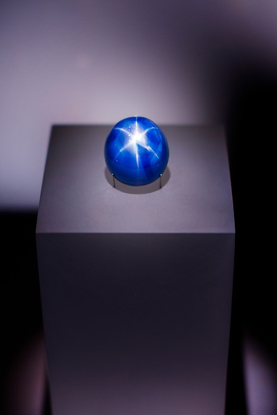 This is the Star of Lanka, the third-largest quality star sapphire in the world, weighing in at 193 carats or about 40 grams. It's a little smaller than a ping-pong ball. Nobody seems to know exactly where or when it was found but, like most fine sapphires, it's from its namesake, Sri Lanka. It was sold to the Royal Ontario Museum, where I shot this picture January 3, in 1958 by US gemologist Allan Caplan. I don't much care for gems and other needful things but I've always liked blue star sapphires because of their colour and the way they catch the light. Mesmerizing rock :-)