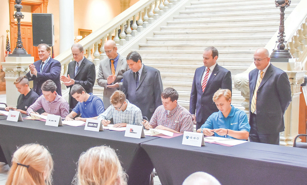 Incoming sophomores sign sign with Georgia manufacturing companies as part of  the 2nd GA CATT cohort of Industrial Mechanics apprentices. The Signing Ceremony was hosted by Lt. Gov. Cagel at the state capitol. <br /> <br /> Front row (from left to right): Jacob Seals, McKinley Hutcheson, Patrick Hildenbrand, Joe Lanave, Christopher Proctor and Kyler Gunn.<br /> Back row (from left to right): Rich Westerfield (VP MFG and Distribution of Yokogawa Corporation of America), John Michalewicz (Senior Manager of Production of KCMA Corporation), Burl Finkelstein (Executive VP and General Counsel of Kason Industries, Inc.), Bob Grillo (Production Manager of  Groov-Pin Corporation), Martin Pleyer (COO of Grenzebach Corporation), and David Keller (President of EGO North America).