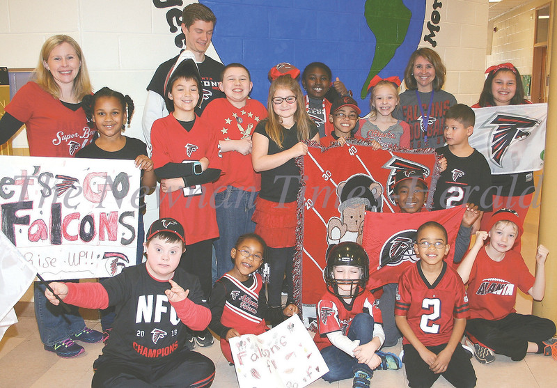 "Thomas Crossroads Elementary 'Rises Up' for Falcons Students, staff and faculty at Thomas Crossroads Elementary School have spent the week getting ready for the Atlanta Falcons' appearance in Sunday's Super Bowl. On Thursday, the school celebrated ""Rise Up"" Day, when students dressed in red and black to show their support. Pictured from left are, front, Jake Jeffries, Mckinley Robinson, Dylan Padovani, Jamari Renteria and Colt Kline; middle row, Mrs. Donna Hightower, Sierra Walker, Conner Whetstone, Kate McManus, Amiel Trott, Miles Parham and Evan Nieves; back row, Tim Brown, Jackson Perez, Ariana Simmons, Kyleigh Hightower, Alison Taylor and Haley Stapp."