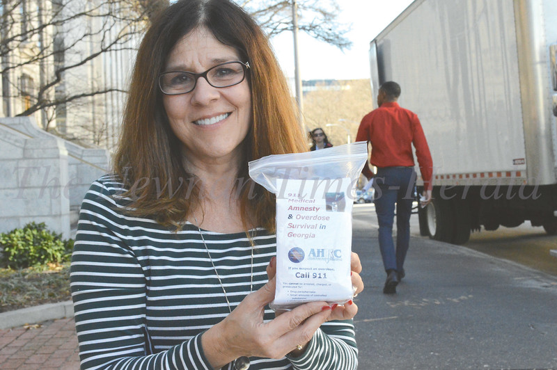 Christine Kendall shows one of the overdose rescue kits given out by Georgia Overdose Prevention at Addiction Recovery Awareness Day at the state capitol.