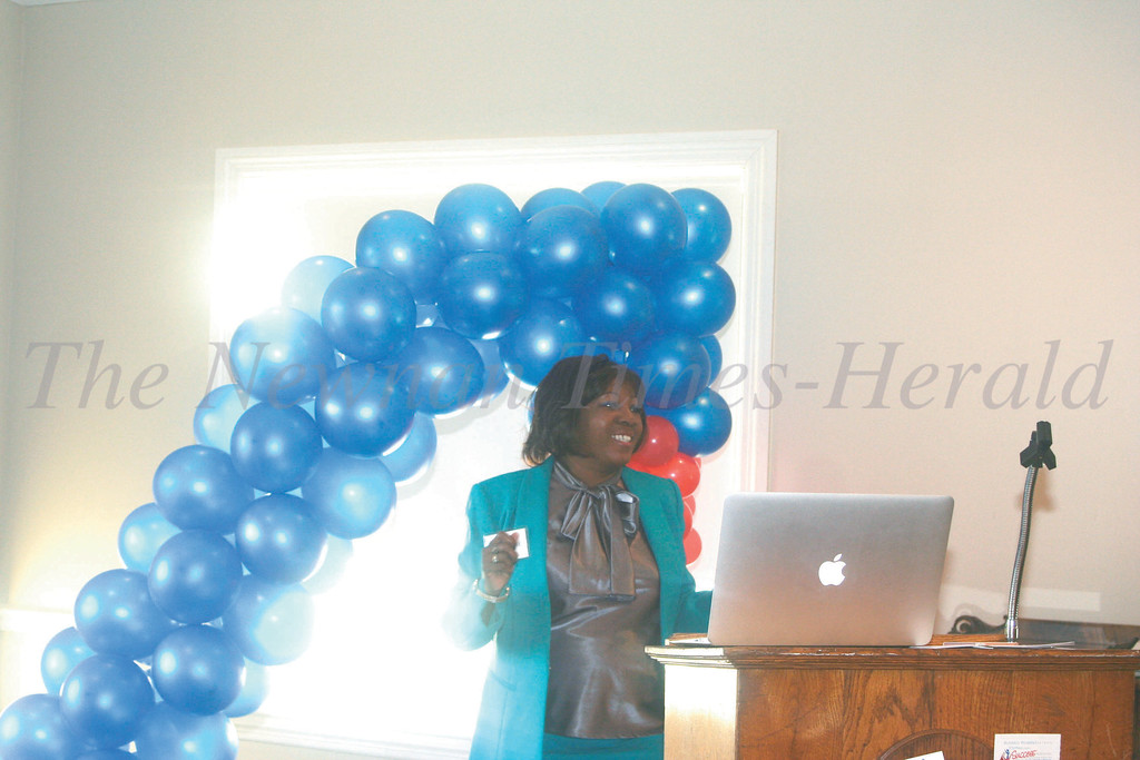 Dr. Blanche Wallace, mentorship program chair, welcomes everyone to the  Stepping into Success kick-off event Tuesday.