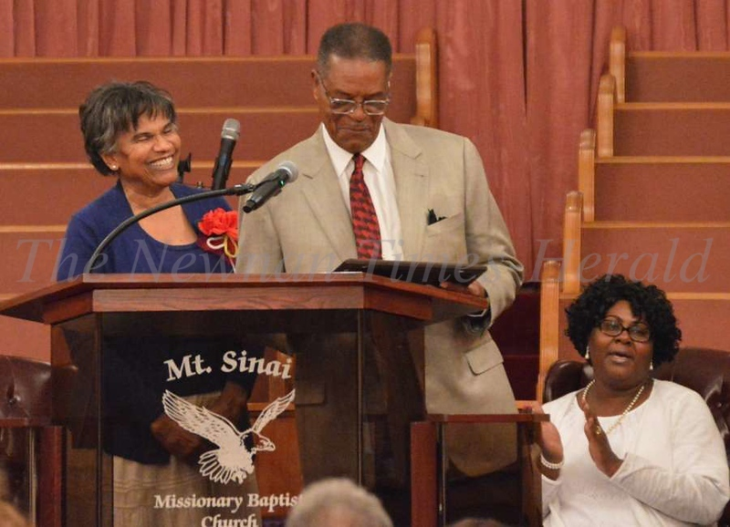 Winston Dowdell was presented with a plaque by Mary Paige, worthy matron of Chapter 483, Order of the Eastern Star, at Friday's MLK commemorative program.