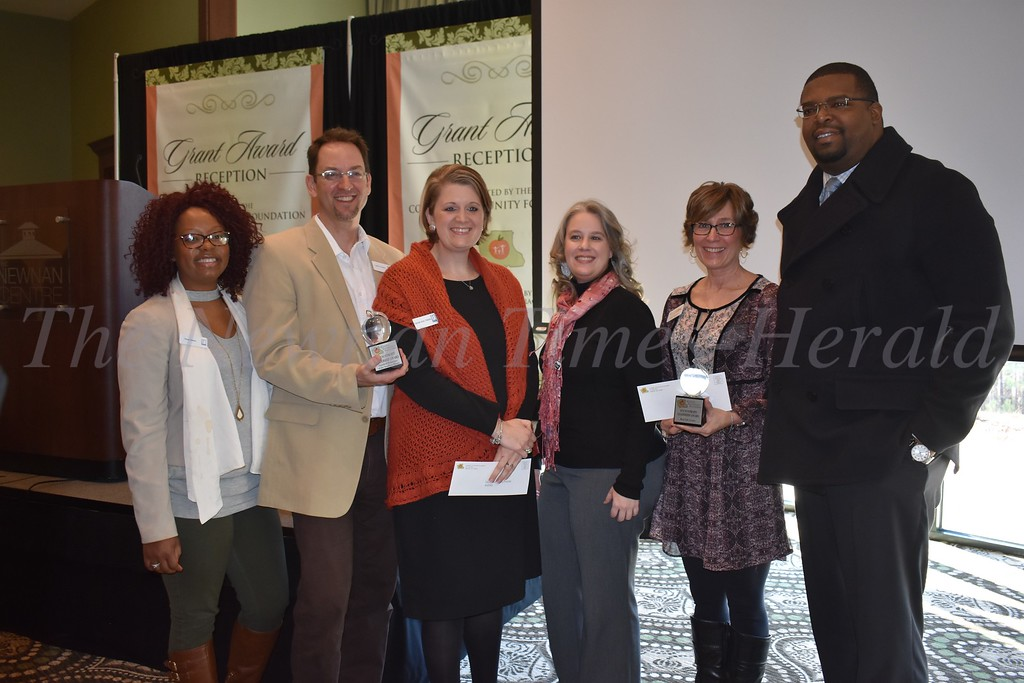 Leadership Awards were presented to Goodwill Southern Rivers, Real Life Center and Flint River Council, Boy Scouts of America. From left are Trina Glenn, Larry Tucker and Carole Ann Fields of Goodwill; Diana Guthrie and Cathy Berggren of Real Life Center; and Kelvin Williams, Scout Executive for the Flint River Council.