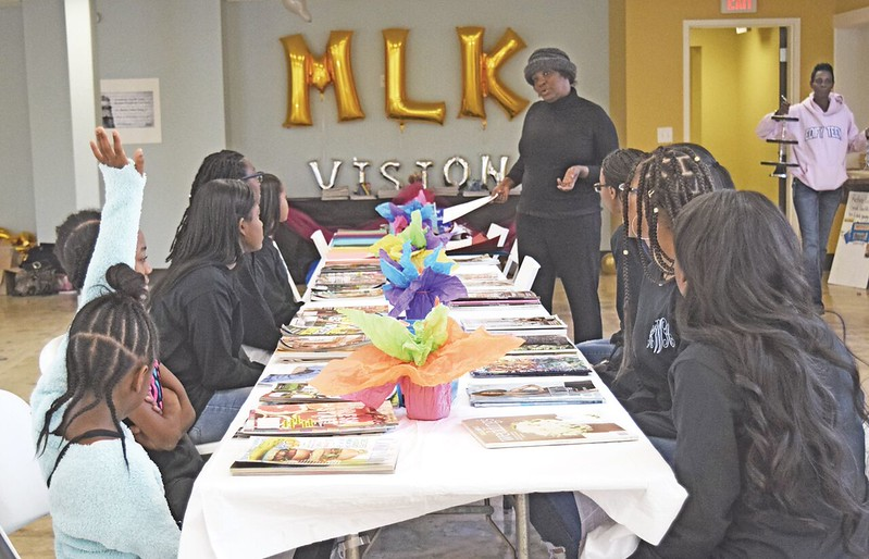 On the Dr. Martin Luther King Jr. holiday, participants enjoy working on vision boards at an event sponsored by Edify Teens.  The event was held at the Howard Warner Community Center.