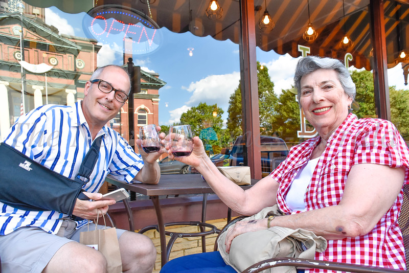 Sitting outside Leaf & Bean, Gary Bernstein enjoys a glass of wine with his mother, Sheila Bernstein, during the Summer Wined-Up held Friday evening in downtown Newnan.