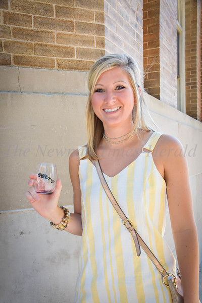 Makinley Cook stands outside the Carnegie Library, ready to get underway during the Summer Wined-Up, held Friday evening in downtown Newnan.