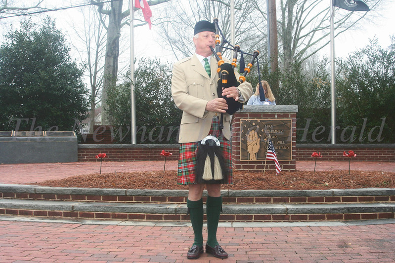 Michael Scott plays the bagpipe during the military tribute at the Blue Star Memorial Marker dedication ceremony yesterday.
