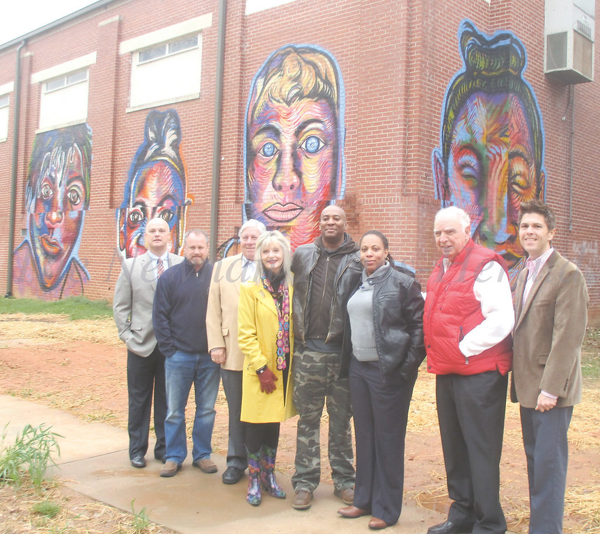 Corey Barksdale gathers with citizens representing the city, the ArtRez project and the Boys and Girls Club at the Wesley Street Gymnasium. From left are Cleatus Phillips, Rob Brass, Ray DuBose, Bette Hickman, Barksdale, Lauren Odom, Bob Coggin and Hasco Craver.