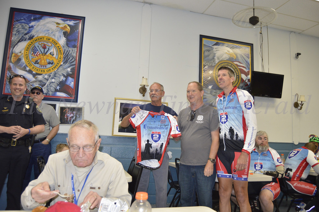 Ride 2 Recovery, a program created for veterans inspired by the healing effects of physical therapy, visited Newnan on a Challenge Ride from Atlanta, Ga. to New Orleans, La. President and Founder John Wordin presents team uniform signed by members to the Newnan Veterans Club.