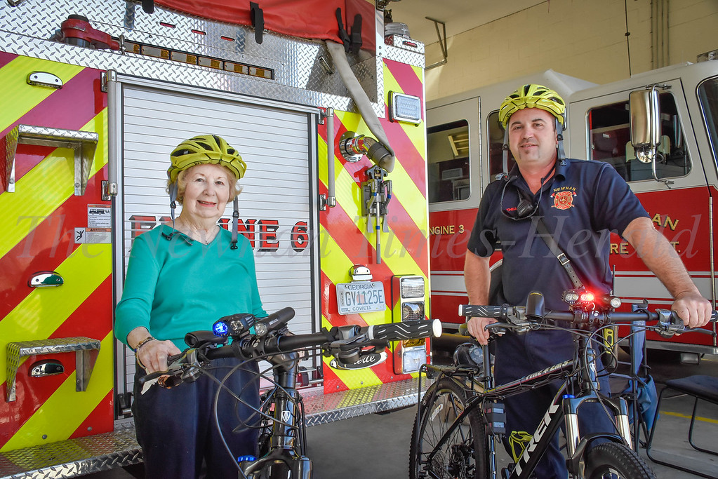 Norma Haynes and Chris Mitchell show of the new rescue bicycles at the Newnan Fire Department