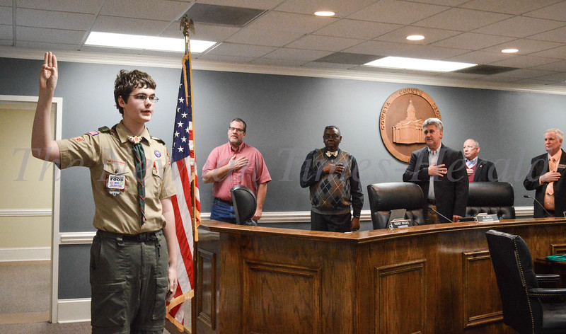 Trey Ishman leads the pledge during the County Commission meeting.