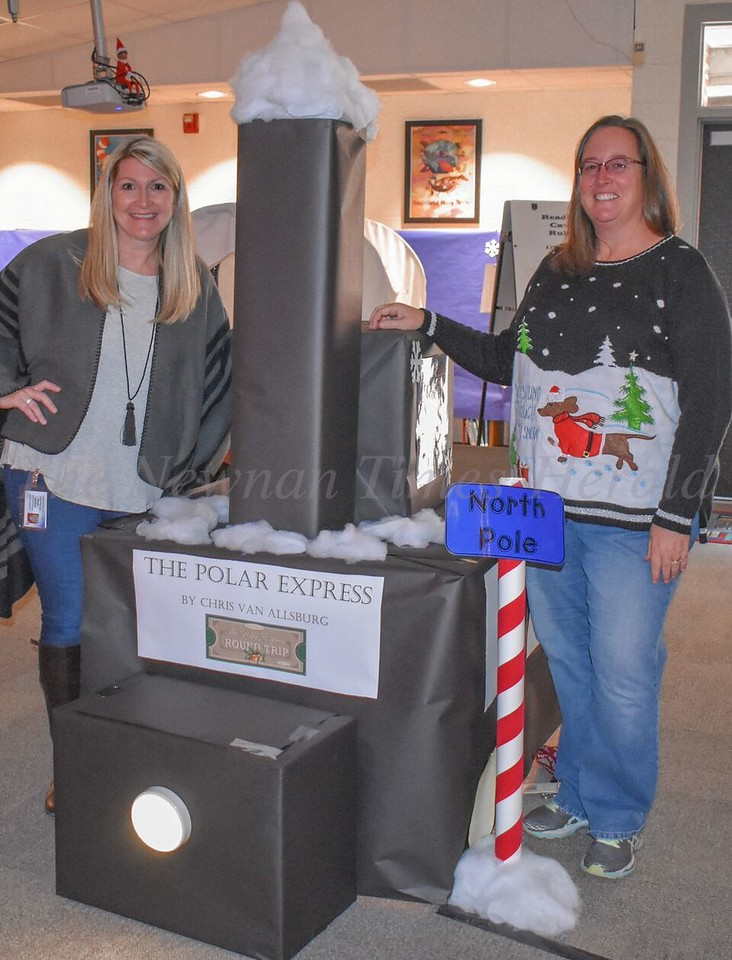 Nothing says Christmas like a ride on the Polar Express according to Elm Street Elementary School's media specialist Shannon Ewing, left, and fifth grade teacher Cece Kuehl, right.