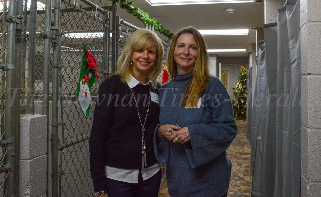 Newnan Coweta Humane Society volunteers Kim McCurry and Sandy Hiser at the Open House for the Humane Society's new headquarters
