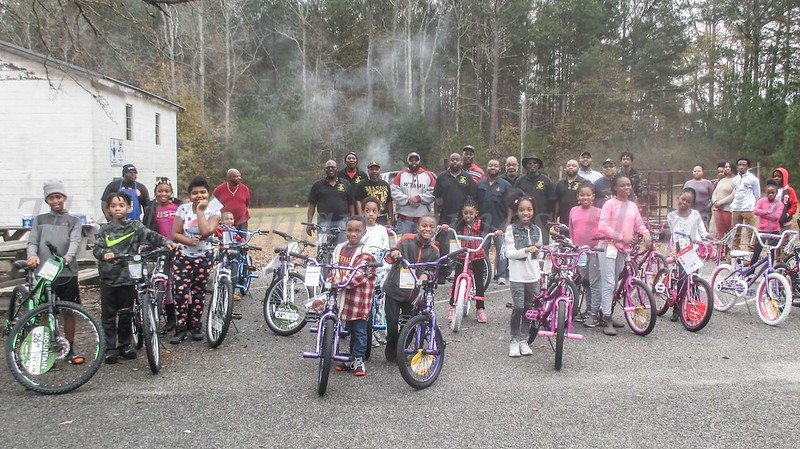 Excited youngsters line up with their new bicycles at Zion Hill Masonic Lodge 26.  Behind them are lodge members.  This marked the second Christmas the lodge has provided bicycles to area youngsters.