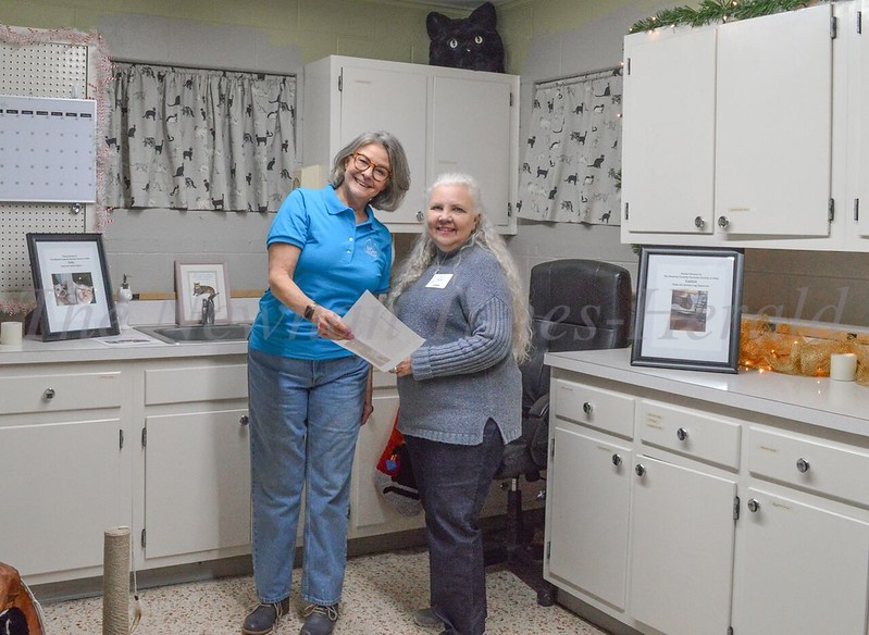 Angie Whitlock, cat program coordinator, and Linda Hart, Newnan-Coweta Human Society president, chat in the cat room at the Open House of their new headquarters.