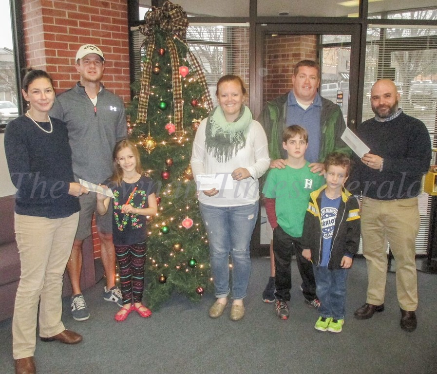 From left to right:  Beth Neely, co-publisher, first place winner Ben Graff with daughter Taylor,  Bracey Pate accepting the second place prize for Nick Wood, third place winner Brendan Shaner with sons Jack and Ben and Clay Neely, co-publisher.