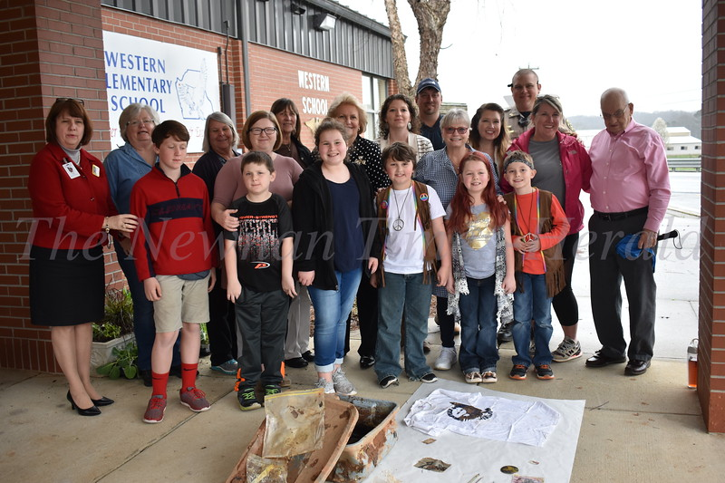 Western Elementary School students and teachers look on the items retrieved from a time capsule buried by fifth graders in 1993.
