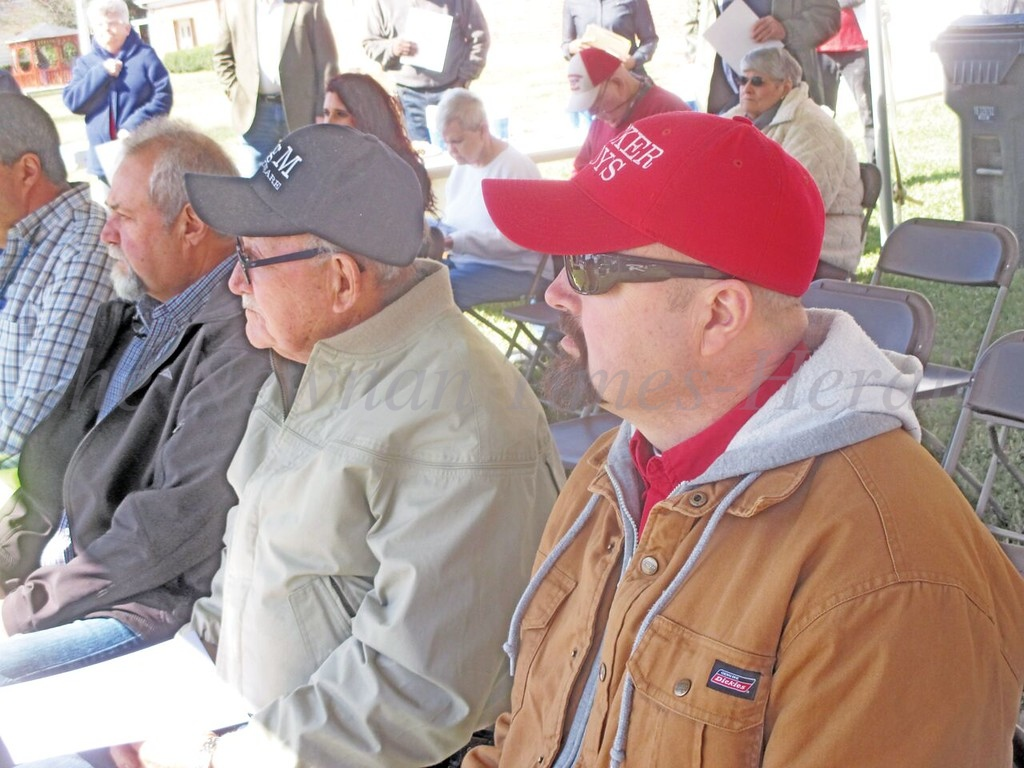 Former Grantville Mayor, Billy Tucker, flanked by his sons, Tony and Chris, listens during the program honoring his late wife, Barbara, on the grounds of the towns headquarters on Thursday morning.