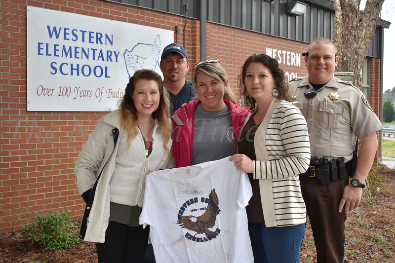 Classmates from Western Elementary School gather at the school to open a time capsule they buried in fifth grade  in 1993. From left to right are Charlotte Dombrowski Patterson, Matt Cash, Sara Perkins, Dewberry, Bree Milnor and Todd Brown.