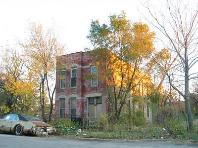 Seemingly abandoned car and house