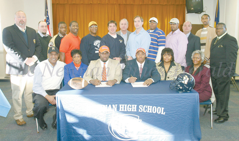 Seated:  J.W. Russell (paster), Patricia Russell (mother) Leland Russell, Dustin Russell, Stephanie Wilburn (mother), and Jerelene Wilburn (Grandmother)<br /> Standing:  Stephan Allen (AD), Joe Wright (trainer), Keandreas Wynn (teammate), Nate Wilson, Jr. (father), Nate Wilson, Sr. (grandfather), Mike McDonald (Defensive Coordinator), Robert Herring (head coach), Ken Kesselring (coach), Dexter Russell (father), Rodney Russell (Uncle), Douglas Moore (Principal), Derrick Teagle (Empowered for Life), and Braland Geter