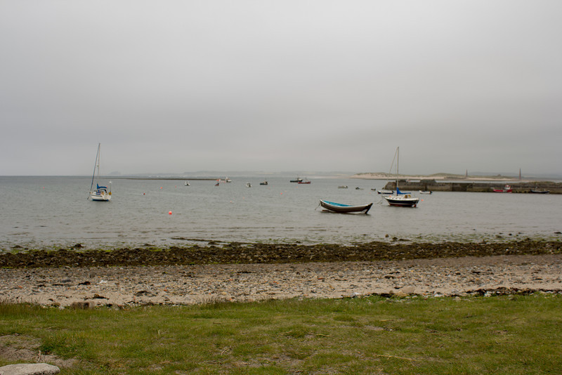 Lindisfarne Harbour on a very grey, overcast and misty day.