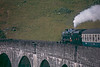 """""""The Jacobite"""" steam service passing over Sir Robert McAlpines viaduct at Glenfinnan."""