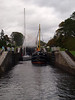 Clyde Puffer VIC32 and private yacht coming down the Caledonian Canal through Neptune's Staircase. Photograph taken at the lower loch of Neptune's Staircase.