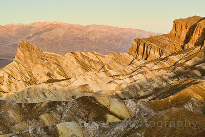 Mountain highlighted by sunrise at Zabriskie Point, Death Valley.  2927b