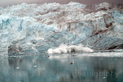 Calving of a glacier while going through Glacier Nat'l Park on a Princess Cruise