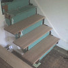 Old stairs had carpet, half of the original treads were split.  Covered with white oak treads and risers.