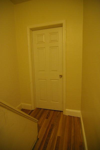 2nd floor hall and door to front bedroom