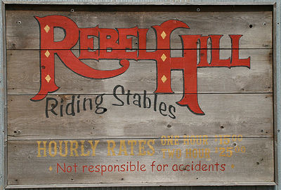 Taken with my Bigma Lens. Sign on the Stable Doors here on the Ranch where the Guests mount up for a Horse Ride.
